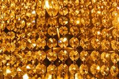 Glänzendes abstraktes Muster des hellen goldenen Goldgelbs, Abschluss oben von De Stockbilder