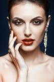 Glänzendes Gesichtsmake-up Stockfoto