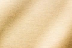 Glänzendes Gold von der Gewebeoberfläche stockfotografie