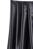 Glänzendes schwarzes silk Drapierung Stockfotografie