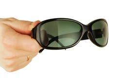 Gläser auf einer womanish Hand Stockfoto