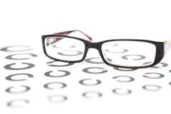 Gläser auf Sehtest Lizenzfreie Stockfotos