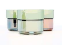 Gläser kosmetischer Lehm lokalisiert auf weißem Hintergrund Lizenzfreie Stockfotos