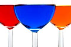 Gläser mit Farbengetränken stockbilder