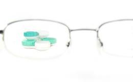 Gläser mit Objektiven Stockbild