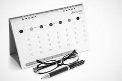 Gläser, Stifte, Kalender Stockbilder