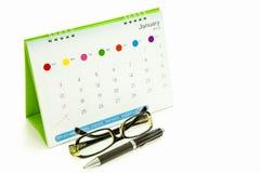 Gläser, Stifte, Kalender Lizenzfreies Stockbild