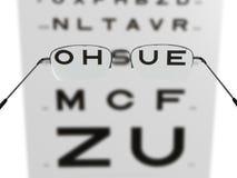 Gläser und Prüfung stockfoto