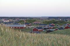Glättung über einer Summerhouse-Gemeinschaft Stockbild