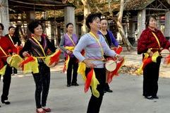 Glåmiga Jia, Kina: Kvinna Midja-Vals band Arkivfoto
