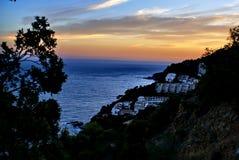 Glöd av solnedgången över havet Arkivbilder