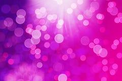 Glöd för lilor för Bokeh bakgrund rosa, cirklar royaltyfria bilder