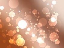Glödande bubblor för guld (Bokeh) Arkivbilder