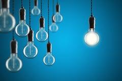 Glödande Edison för idé- och ledarskapbegreppstappning kulor på arkivfoto