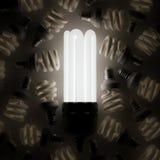 Glödande ljus kula bland andra Fotografering för Bildbyråer