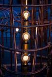 Glödande ljusa kulor som omges av rör Royaltyfria Bilder