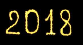 Glödande märka för lyckligt nytt år 2018 för neon som är skriftligt med brandfla royaltyfria foton