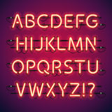 Glödande neonstångalfabet Arkivbild