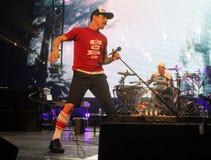 Glödheta Chili Peppers i konsert arkivbild