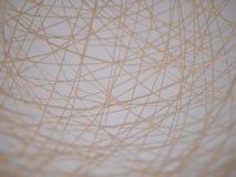 Glödtrådar för fiberexponeringsglas eller glasfiberomkullkastar i panelljuset, abstrakt texturbakgrund Royaltyfri Bild
