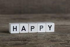 Glücklich, geschrieben in Würfel Stockfotos