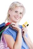 Glücklich Kauf eines attraktiven blonden Mädchens. Stockfoto