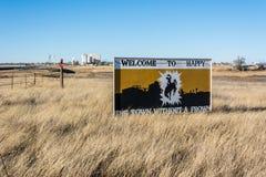Glücklich, Texas - die Stadt ohne ein Stirnrunzeln 'Willkommensschild lizenzfreie stockbilder