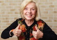 Glückliche ältere Frau Lizenzfreie Stockfotos