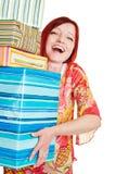 Glückliche Frau, die viele Geschenke trägt Stockbild