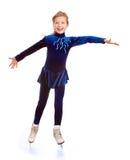 Glückliche Abbildung Eislauf des jungen Mädchens. Stockbild