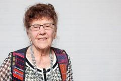Glückliche alte Frau Stockfoto