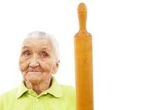 Glückliche alte Frau mit einem Rollenstift Stockbild