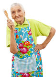 Glückliche alte Frau mit hölzernem Löffel Stockbilder