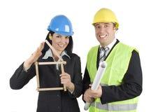 Glückliche Architekten mit Projekt Lizenzfreies Stockfoto