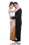 Glückliche asiatische Hochzeitspaare Lizenzfreie Stockfotografie