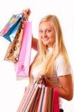 Glückliche blonde Einkaufenfrau mit dem langen Haar Lizenzfreies Stockfoto