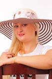 Glückliche blonde Frau in einem Hut Lizenzfreies Stockbild