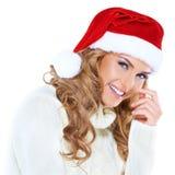 Glückliche blonde Frau mit einem roten Sankt-Hut Stockbild