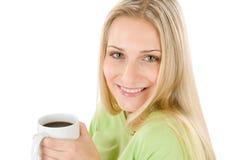 Glückliche blonde Frau mit Kaffee auf weißem Hintergrund Lizenzfreie Stockbilder