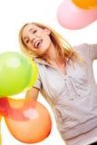 Glückliche Blondine mit vielen Ballonen Stockbild