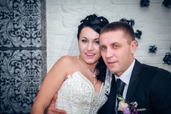Braut und Bräutigam an ihrem Hochzeitstag Stockbilder