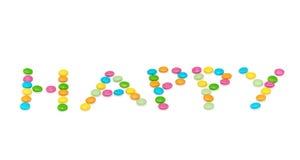 Glückliche Buchstaben mit den farbigen Kerzen an lokalisiert Lizenzfreies Stockbild
