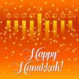 Glückliche Chanukka-Grußkarte, Lichter auf Orange Goldenes bokeh backgorund Lizenzfreie Stockfotografie
