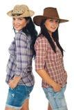 Glückliche Cowgirle mit Hüten Stockfoto
