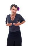 Glückliche Dragqueen, die seine Brüste halten Stockfoto