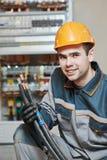 Glückliche Elektrikerarbeitskraft stockbilder