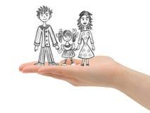 Glückliche Familie in der Hand lizenzfreie stockfotos