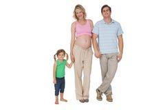 Glückliche Familie, die eine Neuheit lächelt an der Kamera erwartet stockfoto