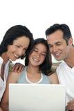 Glückliche Familie mit einem Kind Lizenzfreies Stockfoto