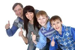 Glückliche Familie mit Kinderdem lächeln Lizenzfreie Stockfotografie